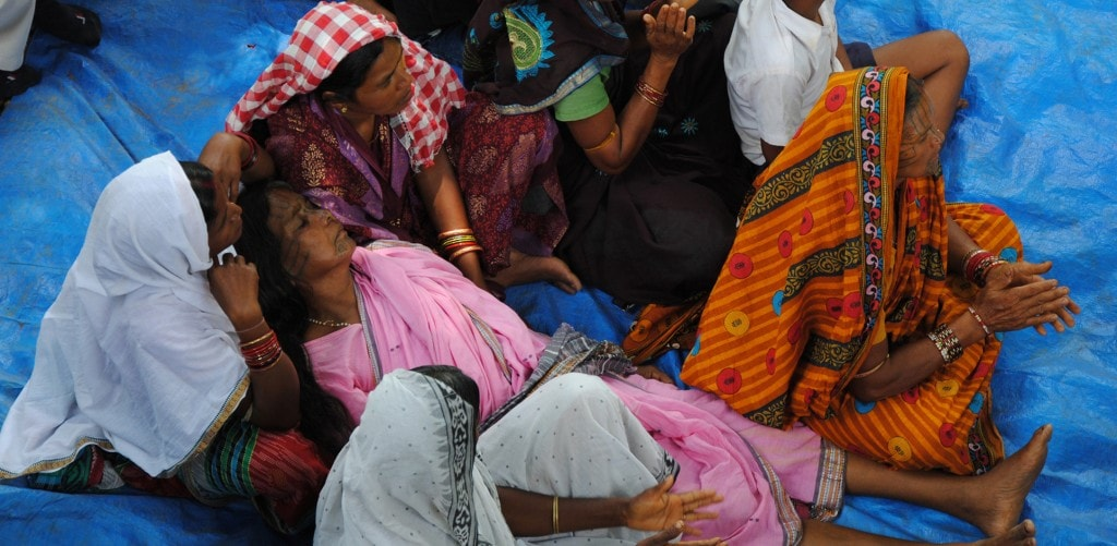 ANGRY VILLAGERS AT THE SITE OF THE BROKEN TEMPLE. THE WOMAN IN PINK SARI FAINTED SEVERAL TIMES, CLAIMING THAT THE GODDESS OF THE TEMPLE WAS SPEAKING THROUGH HER.