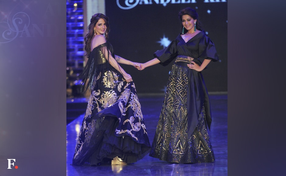 Sussane Khan and Sonali Bendre strike a pose on the ramp. Sachin Gokhale/Firstpost