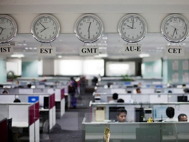 Workers are pictured beneath clocks displaying time zones in various parts of the world at an outsourcing centre in Bangalore February 29, 2012. The business of storing, decoding and analysing unstructured data - think video, Facebook updates, Tweets, Internet searches and public cameras - along with mountains of facts and figures can help companies increase profits, cut costs and improve service, and is now one of the world's hottest industries. It's called Big Data, and although much of the work is done in the United States, India is getting an increasing slice of the action, re-energising an IT sector whose growth has begun to falter. Picture taken February 29, 2012. REUTERS/Vivek Prakash (INDIA - Tags: BUSINESS EMPLOYMENT POLITICS) - RTR38WHY