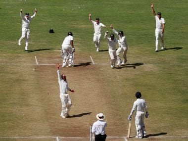 Australia's players celebrate after winning the match against India. Reuters