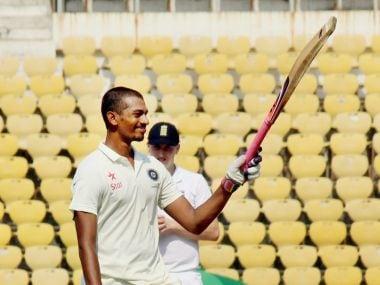 :India U-19 batsman Daryl S Ferrario raises his bat celebrates his century against England during the Test match at VCA stadium in Nagpur on Wednesday. PTI