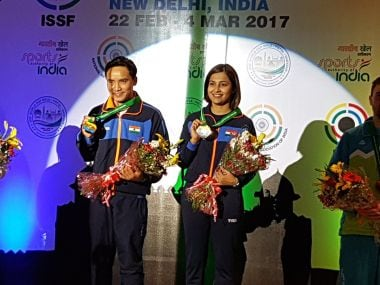 Jitu Rai and Heena Sindhu with their medasl. Image courtesy: Twitter/@CoachRonak