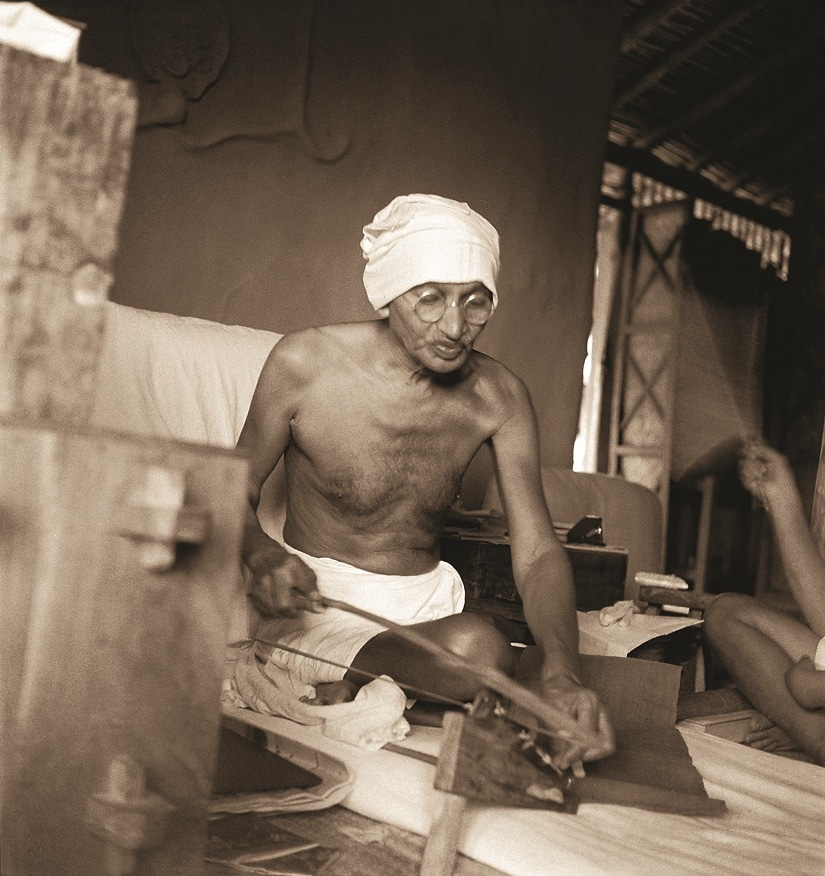 Mahatma Gandhi spinning on Dhanush Takli spinning instrument in his hut at Satyagraha Ashram, Sevagram, August 1940. Photograph by Kanu Gandhi / © The Estate of Kanu Gandhi [A photograph from the exhibition 'KANU'S GANDHI' which follows the publication of Nazar Photography Monographs 03 – 'KANU'S GANDHI'.]