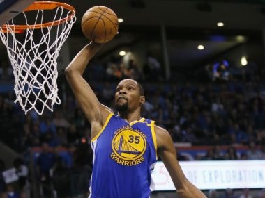 Golden State Warriors forward Kevin Durant goes up for an unopposed dunk against Thunder. AP
