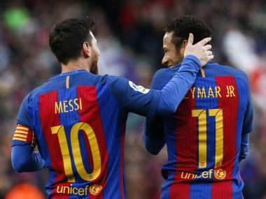 Barcelona's Lionel Messi talks to teammate Neymar after scoring their second goal. Reuters