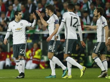 Manchester United's Henrikh Mkhitaryan celebrates scoring with teammates. Reuters