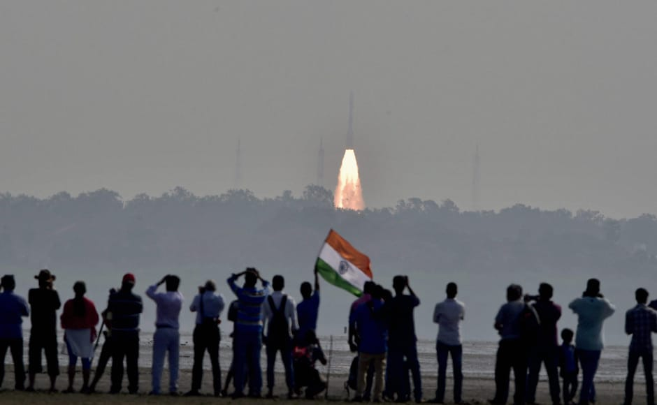 People watch as as a rocket from space agency Indian Space Research Organisation (ISRO) takes off successfully to launch a record 104 satellites, including India's earth observation satellite on-board PSLV-C37 from the spaceport of Sriharikota on Wednesday. PTI