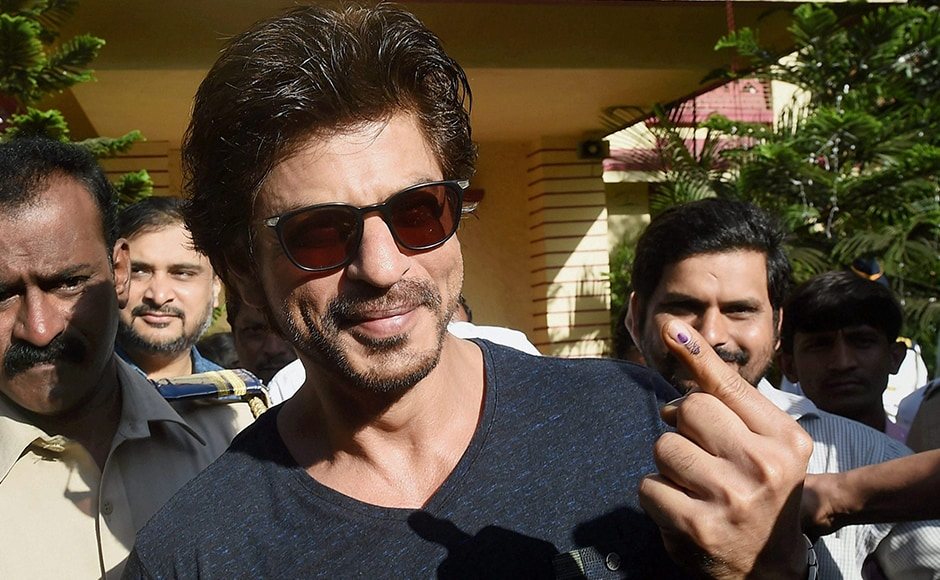 Bollywood superstar Shahrukh Khan shows his ink-marked finger after casting the vote for the Municipal Corporation election in Mumbai on Tuesday. PTI