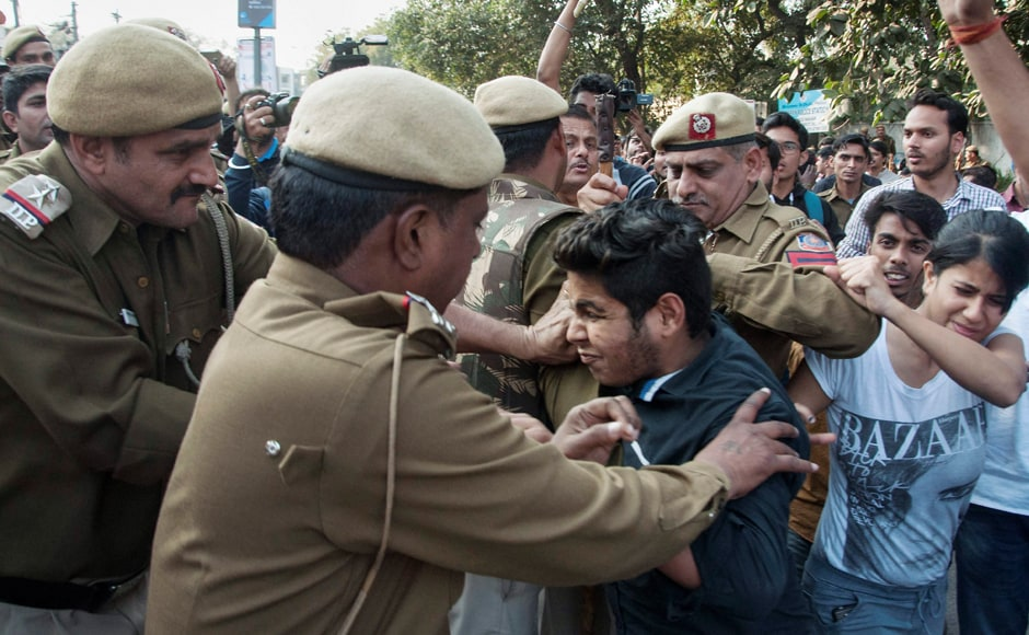 Police detain ABVP students after their clash with All India Students Association (AISA) members at Delhi University north campus in New Delhi on Wednesday. PTI Photo (PTI2_22_2017_000195B)