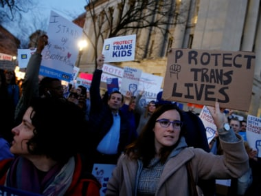 Transgender activists and supporters protest in defense of transgender student rights, near the White House in Washington. Reuters