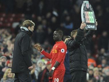 Liverpool manager Juergen Klopp congratulates goalscorer Sadio Mane. AP
