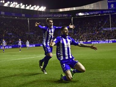 Alaves's Edgar Mendez celebrates his goal with Iabi Gomez after scoring against Celta. AP