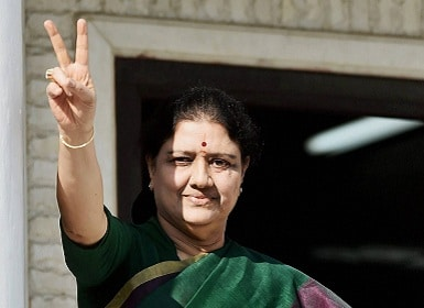 VK Sasikala flashes a victory sign after attending the party meeting in which it was decided she would become Tamil Nadu CM. PTI