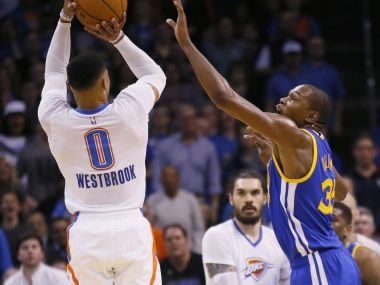 Oklahoma City Thunder guard Russell Westbrook shoots over Golden State Warriors forward Kevin Durant. AP