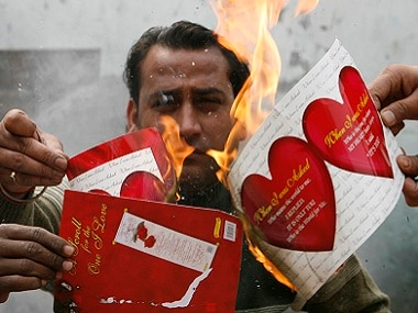 Activists from a hardline Hindu group burn Valentine's cards during a protest in the northeastern Indian city of Siliguri February 12, 2008. Valentine's Day, which is celebrated around the world on February 14, is a relatively new western celebration in India, which has been slammed by some hardliner Hindus for eroding traditional Indian culture. REUTERS/Rupak De Chowdhuri (INDIA) - RTR1WZOU