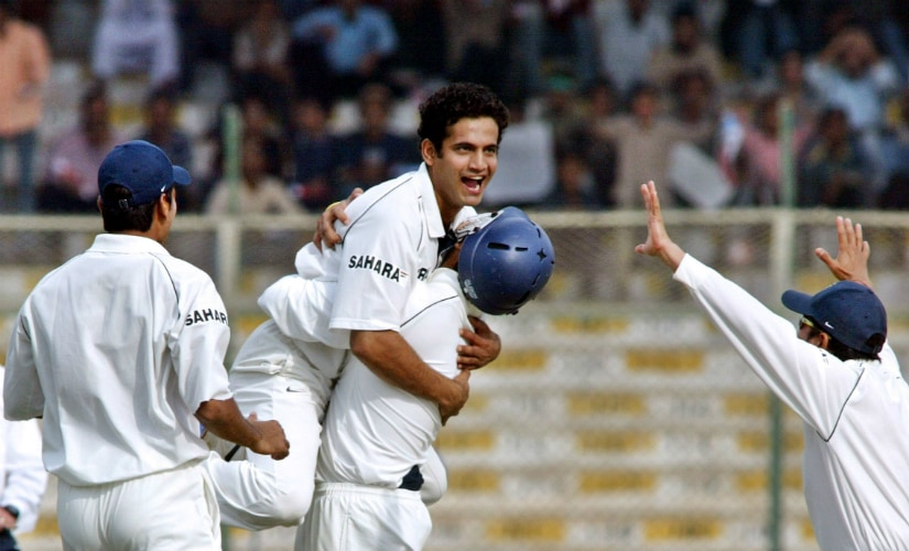 Irfan Pathan (C) celebrates with teammates after taking a hat-trick with the wicket of Pakistani batsman Mohammad Yousuf on the first day of the third and final Test against Pakistan in Karachi in 2006. AFP