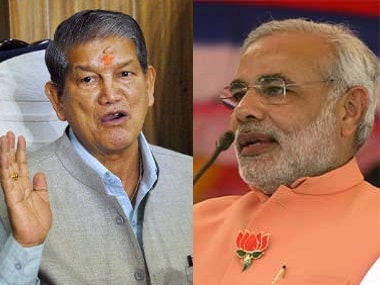 File photo of Uttarakhand CM Harish Rawat (L) and Prime Minister Narendra Modi. Agencies