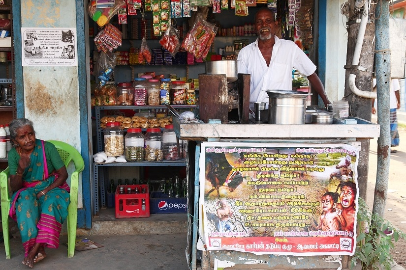 In Avanam, a village on the way to Neduvasal, a tea shop owner, shows his solidarity through posters pasted on his shop front and walls.