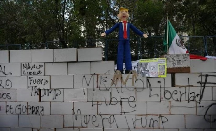 A symbolic wall and a pinata representing the U.S. President Donald Trump is seen during a protest outside the U.S. embassy, in Mexico City, Mexico January 20, 2017. REUTERS/Edgard Garrido/Files