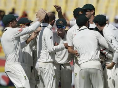 Australia players celebrate an Indian wicket on Day 2. AP