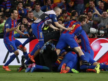 Barcelona players celebrate after winning against PSG. AFP