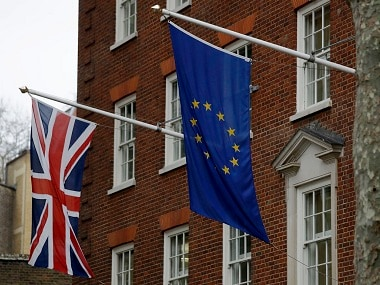 A European and British Union flags hang outside Europe House in London. AP