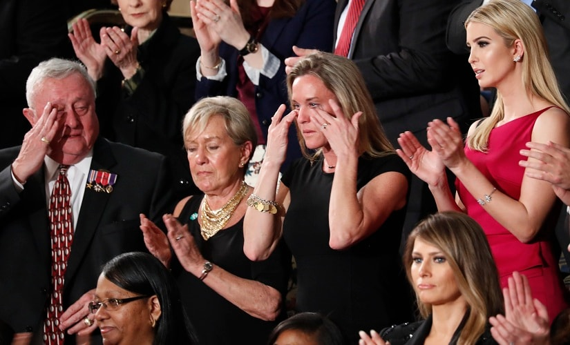 """Carryn Owens, widow of widow of Chief Special Warfare Operator William """"Ryan"""" Owens, wipes her eyes on Capitol Hill in Washington on Tuesday. AP"""