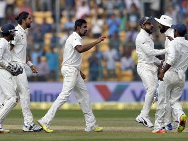 Indian players celebrate their win over Australia in the second Test. AP