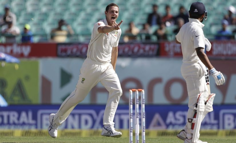 Australia's Josh Hazlewood celebrates the dismissal of India's Murali Vijay, right at Dharamsala. AP
