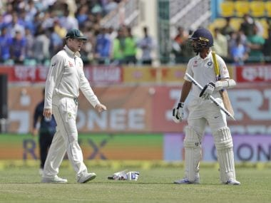 Australia's captain Steven Smith, left, walks towards India's Ajinkya Rahane, after India won the fourth Test. AP