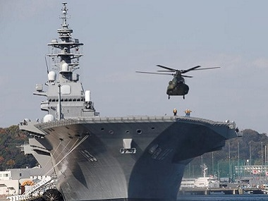 A helicopter lands on the Izumo, at JMSDF Yokosuka base in Yokosuka, south of Tokyo. Reuters