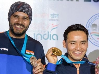 Jitu Rai and Amanpreet Singh pose with their respective medals at the ISSF World Cup in New Delhi. Twitter/ @ISSF