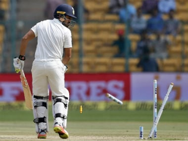 Karun Nair watches his leg-stump breaking into two by a Mitchell Starc thunderbolt. AP