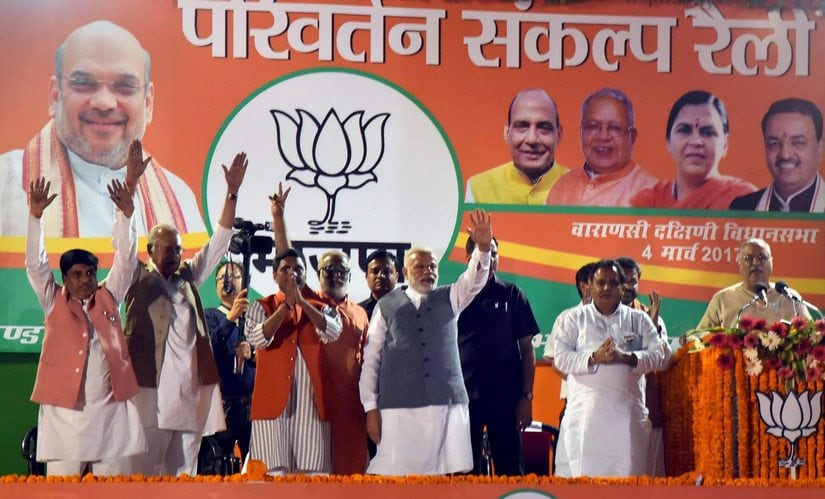 Prime Minister Narendra Modi waves during an election campaign rally in Varanasi on Saturday. PTI