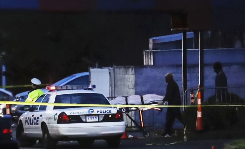 A body is removed as police work at the Cameo club after a fatal shooting on Sunday in Cincinnati. AP