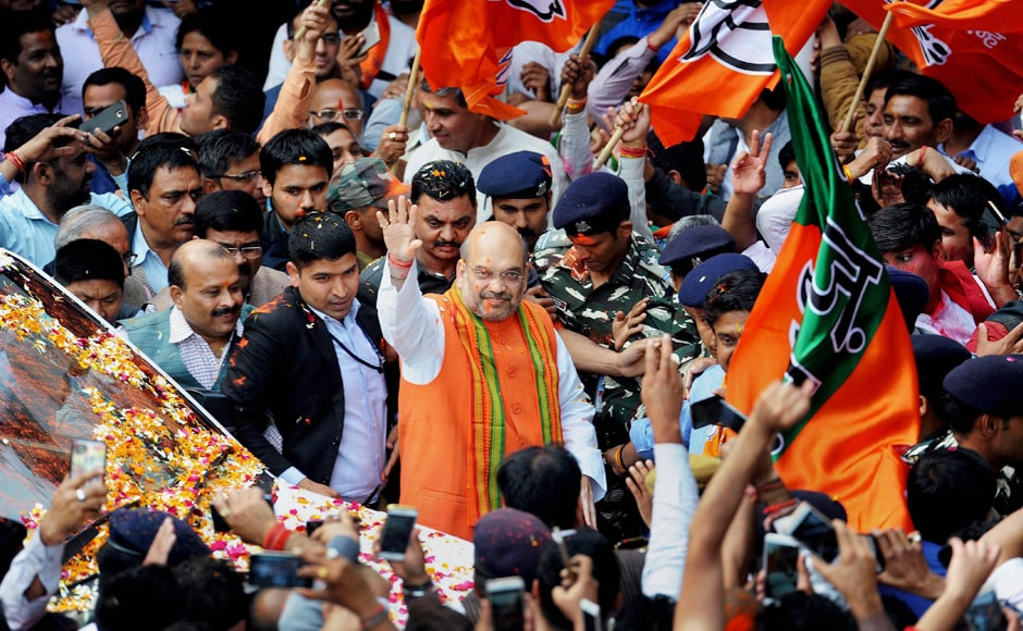 Amit Shah celebrates BJP victory in UP, Uttarakhand with party workers in Delhi