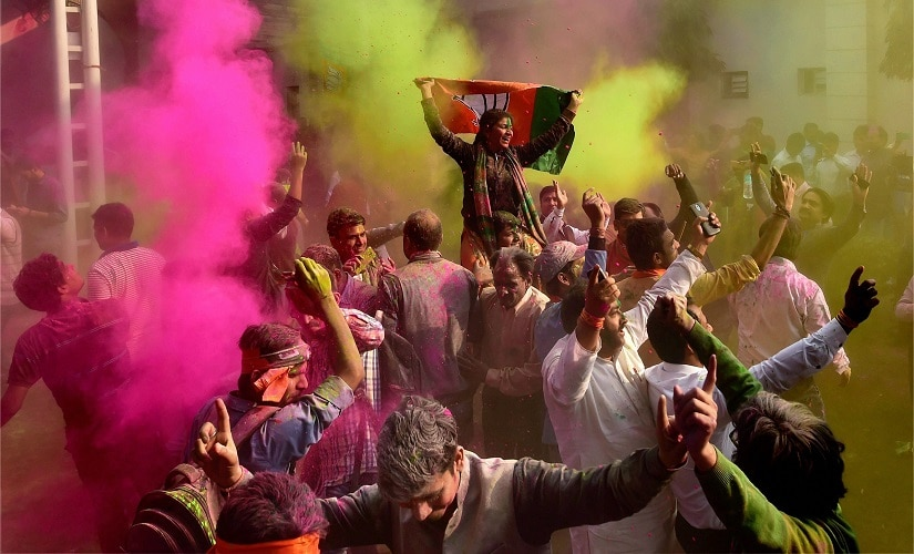 BJP workers play holi as they celebrate the party's victory in the UP and Uttarakhand Assembly elections. PTI