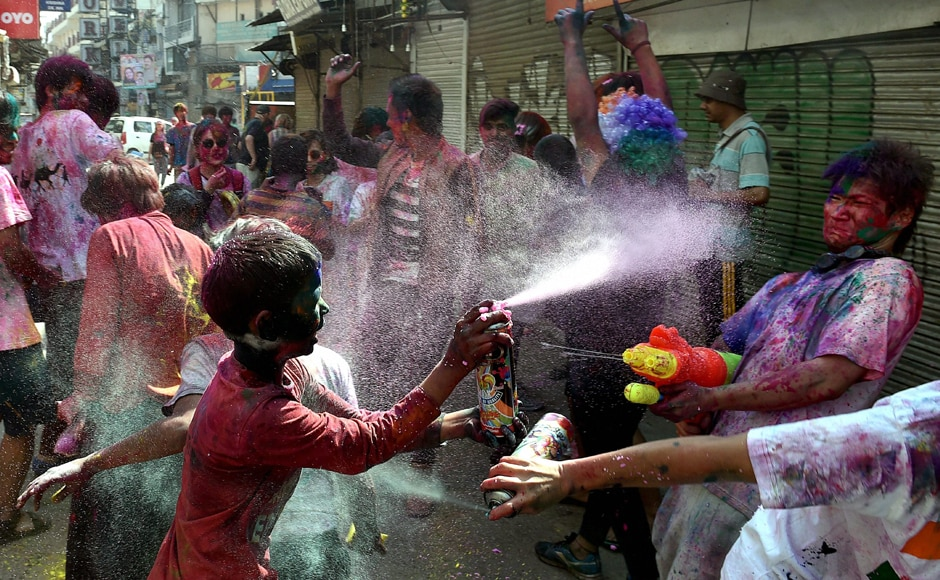 Kids enjoy spraying water on each other on the occasion of ' Holi festival' celebration at Pahargaj area in New Delhi on Monday. PTI