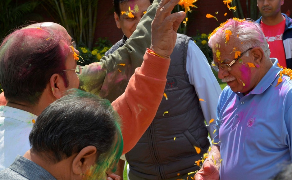 Chandigarh: Haryana Chief Minister Manohar Lal Khattar receives Holi greetings at his residence in Chandigarh on Monday. PTI