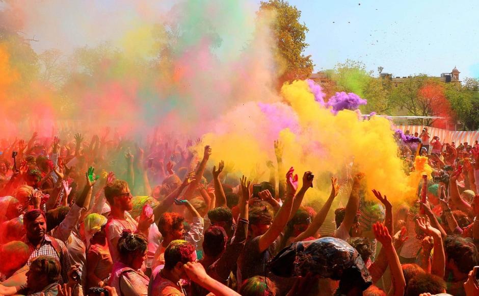 Locals and foreigners celebrating Holi festival at Khasa Kothi in Jaipur on Monday. PTI