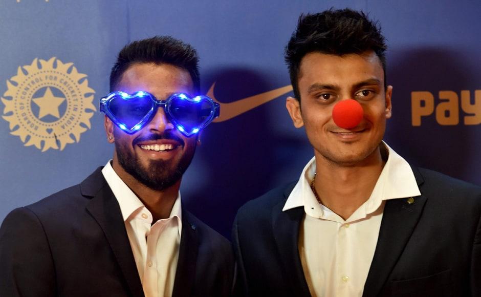Cricketer Hardik Pandya and Axar Patel during the BCCI Annual awards in Bengaluru on Wednesday. PTI Photo by Shailendra Bhojak(PTI3_9_2017_000001B)
