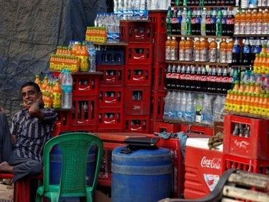 A vendor waits for customers at his shop New Delhi. Reuters