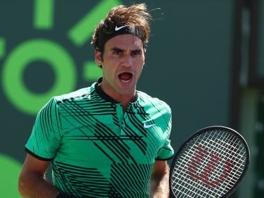 Roger Federer celebrates a point against Juan Martin Del Potro during the Miami Open. Getty