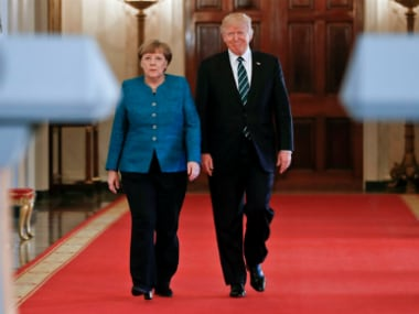 Donald Trump sidesteps blame over wiretap row with Britain, revives another in meeting with Angela Merkel
