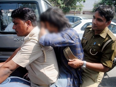 """Lucknow: Anti-Romeo squad of police detaining a youth in Lucknow on Wednesday.  """"Anti-Romeo squads"""" ordered by new Chief Minister of Uttar Pradesh, Yogi Adityanath have started work across the state. PTI"""
