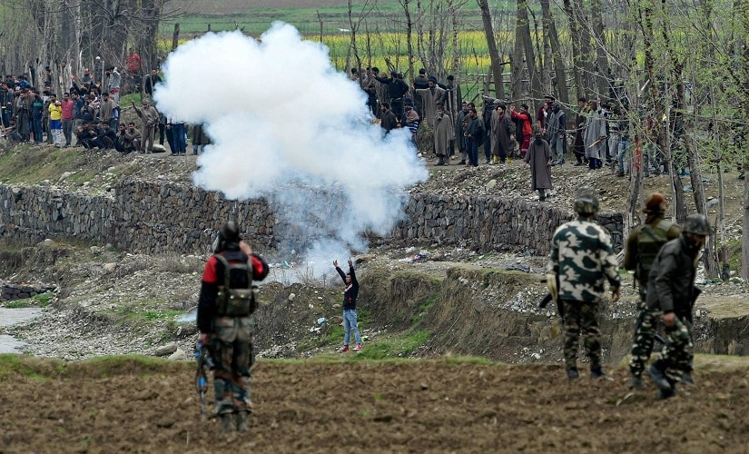 Local protesters try to disrupt an anti-militant operation at village Durbugh in Chadoora area of central Kashmir's Budgam district on Tuesday. PTI