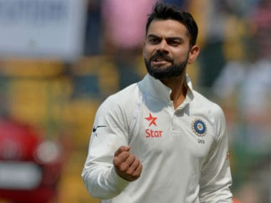 Kohli reacts as he walks back to the pavilion for tea during Day 4 of the second Test between India and Australia in Bangalore. AFP