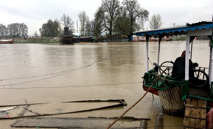 Mohammad Yusuf, 56, owner of a houseboat on Jhelum, said he is ready to move out because of the floods. Picture: Firstpost/Sameer Yasir
