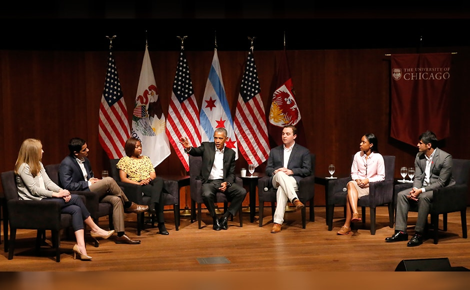 Former President Barack Obama, center, hosts a conversation on civic engagement and community organizing, Monday, April 24, 2017, at the University of Chicago in Chicago. From left are, Kelsey McClear, Loyola University; Ramuel Figueroa, Roosevelt University; Tiffany Brown a pharmacist; Obama, Max Freedman, University of Chicago; Ayanna Watkins, Kenwood High School; and Harish Patel, New America. (AP Photo/Charles Rex Arbogast)