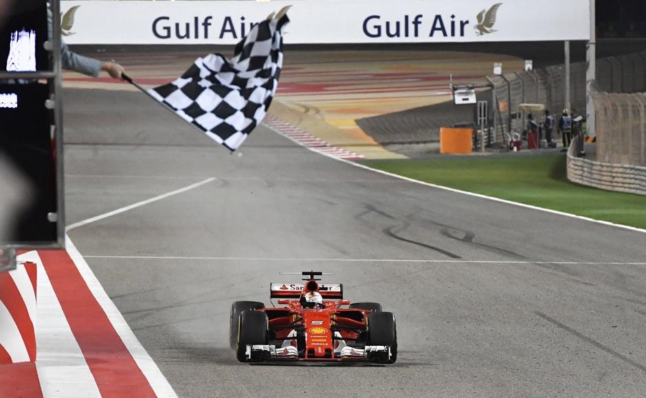 Ferrari driver Sebastian Vettel of Germany crosses the finish line to win the Bahrain Formula One Grand Prix, at the Formula One Bahrain International Circuit in Sakhir, Bahrain, Sunday, April 16, 2017. (AP Photo/Andrej Isakovic, Pool)